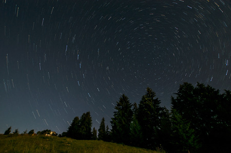messier: Nightly landscape with star traiis Stock Photo