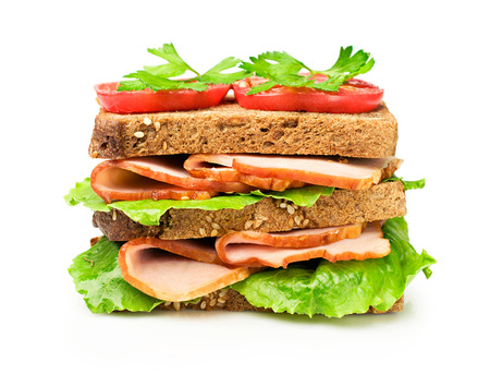 sandwich white background: Sandwich with a ham and tomatoes isolated over white Stock Photo