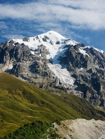 upper: Mountain Tetnuld in Caucasus. Upper Svaneti, Georgia