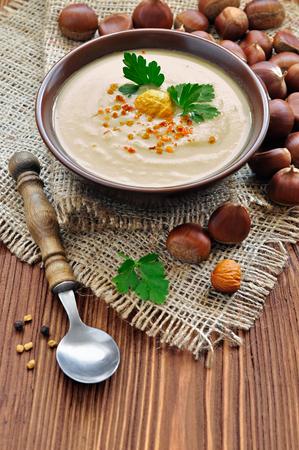 Chestnut soup in a rustic stile Imagens