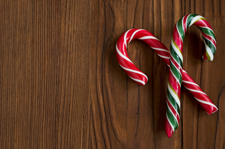 christmastide: Christmas candy on a wooden background