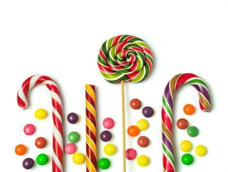 カラフルなクリスマスのお菓子は、白で隔離 写真素材