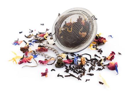 tea strainer: Herbal tea and tea strainer isolated on white background