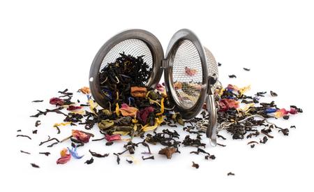 tea strainer: Herbal tea and tea strainer on white background