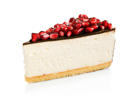a portion: Cheesecake with chocolate and pomegranate isolated over white Stock Photo