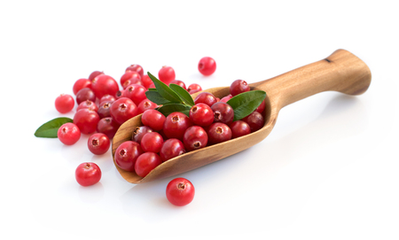Cranberry with wooden scoop isolated over white
