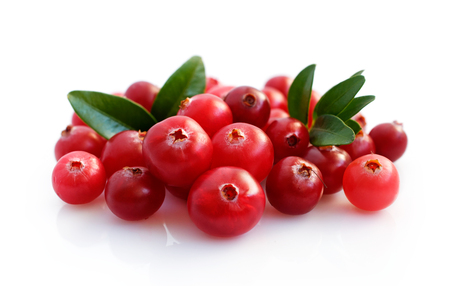 Fresh cranberries with leaves isolated on white 写真素材