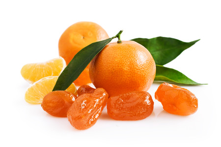 candied fruits: Mandarin and candied fruits isolated on white background