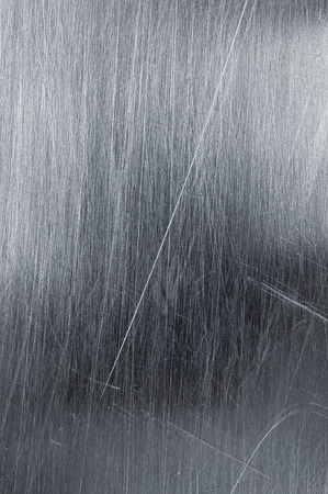 scratches: Shiny metallic textured background with scratches