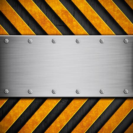 hazard stripes: Polished metal texture with yellow hazard stripes Stock Photo