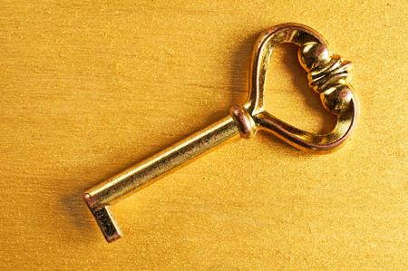golden key: Golden key on a golden background. Success concept
