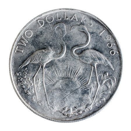 bahamian: Old silver coin in two Bahamian dollar isolated over white