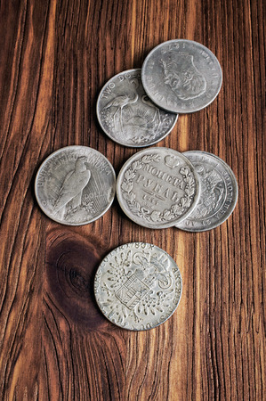thaler: Old silver coins on wooden. Dollar, ruble, thaler Stock Photo