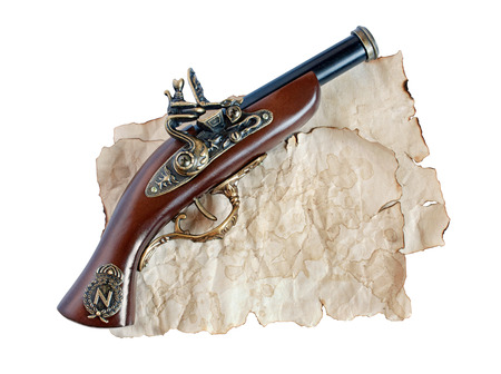 flint gun: Beautiful old musket or pistol and paper isolated on white background Stock Photo
