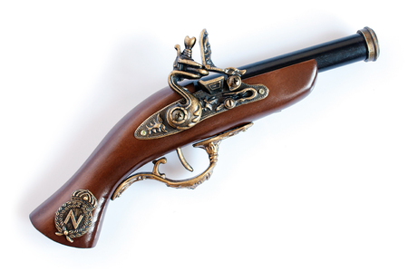 flint gun: Beautiful old musket or pistol isolated on white background