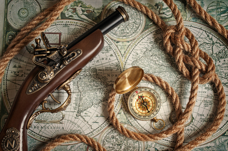musket: Ancient musket, compass and rope lying on the old map