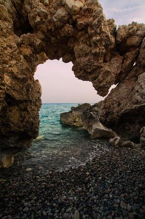 tou: Stone caves or grotto on the beach Petra tou romiou, Cyprus. Stock Photo