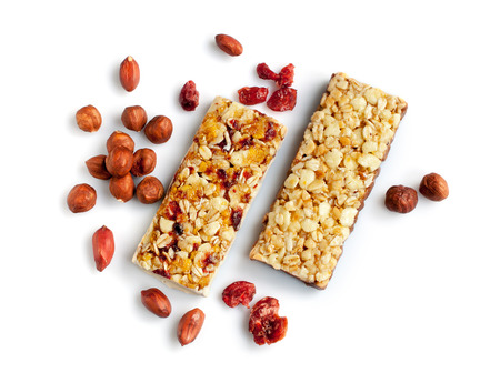 Healthy cereal bars with nuts isolated on white background 版權商用圖片