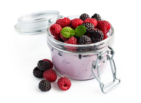 black raspberries: Yogurt with red and black raspberries isolated on white background