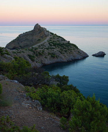 Sunset landscape with a Cape Kapchik. Crimea Stock Photo