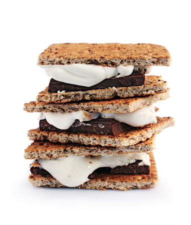 american cuisine: Fresh homemade smores with marshmallows, chocolate and graham crackers isolated on white background. The popular American cuisine dessert. Stock Photo
