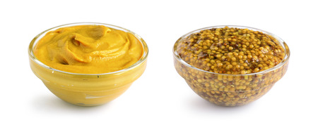 wholegrain mustard: Mustard sauce and wholegrain mustard in two glass bowls isolated on white Stock Photo