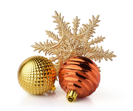 Golden Christmas balls and decorative snowflake isolated on white background. Christmas decoration.