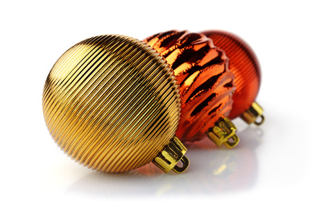 Golden and red Christmas balls isolated on white background. Christmas decoration.