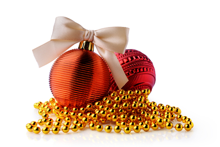 Golden and red Christmas balls with ribbon bows isolated on white background. Christmas decoration.