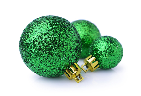 Three green Christmas balls isolated on white background