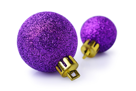Two violet Christmas balls isolated on white background