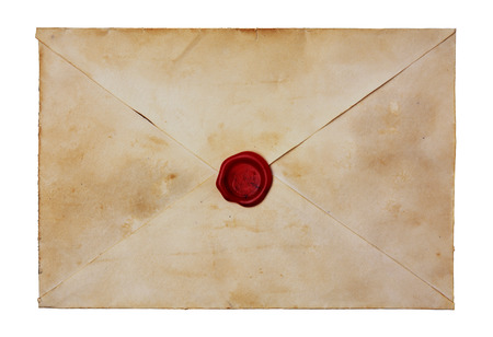Old envelope with red sealing wax isolated on white