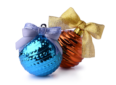 Blue and orange Christmas balls with ribbon bows isolated on white