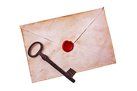 Old envelope with red wax and rusty key isolated on white background Stock Photo