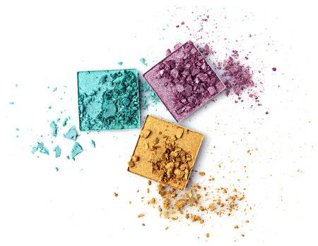 Crushed multicolored eyeshadows isolated on white Stock Photo