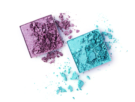 Teal and purple broken eyeshadows isolated on white