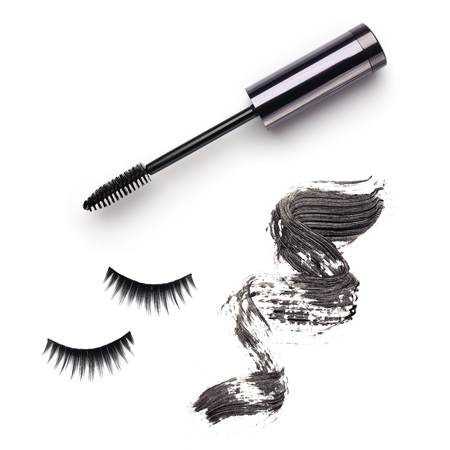 Set with mascara, strokes and false lashes isolated on white background
