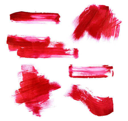 Set of red paint strokes isolated on white background