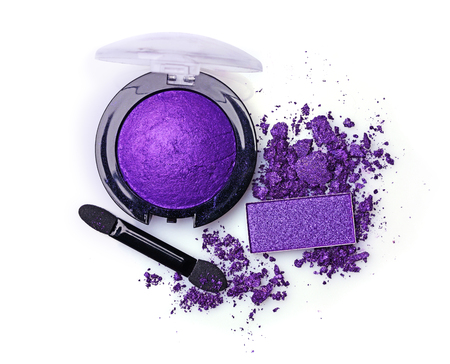applicator: Crushed violet eyeshadow and applicator isolated on a white background