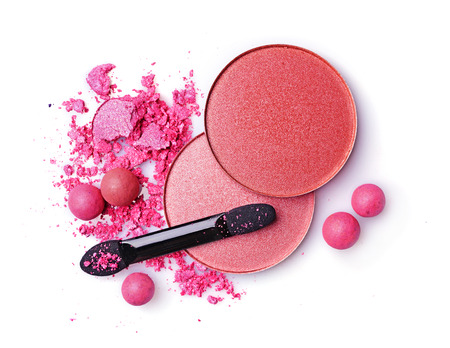 grooming product: Crushed blush and eyeshadow with applicator isolated on a white background