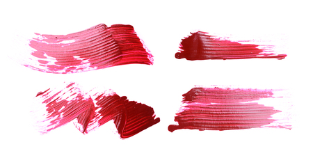 Set of red brush strokes of acrilic paint as sample of art product isolated on white background