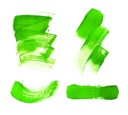 Set of green brush strokes of acrilic paint as sample of art product isolated on white background