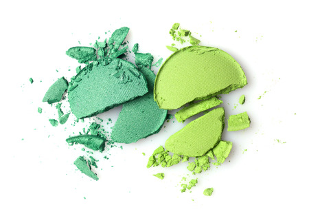 Round green crashed eyeshadows for make up as sample of cosmetics product isolated on white background