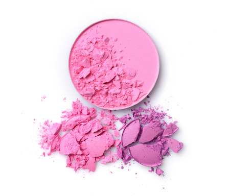 Round pink blusher and purple crashed eyeshadow for make up as sample of cosmetics product isolated on white background