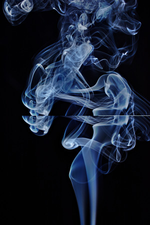 Transparented colorful cloud of smoke isolated on black background Stock Photo