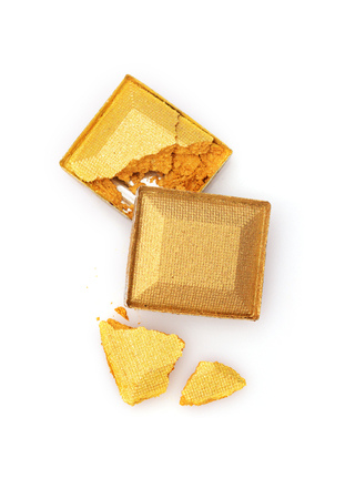 saturated: Golden crashed eyeshadow for make up as sample of cosmetic product isolated on white background