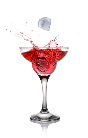 daiquiri alcohol: Splash in glass of a pink alcoholic cocktail drink with ice isolated on white background Stock Photo