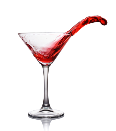 daiquiri alcohol: Splash in glass of a red alcoholic cocktail drink isolated on white background