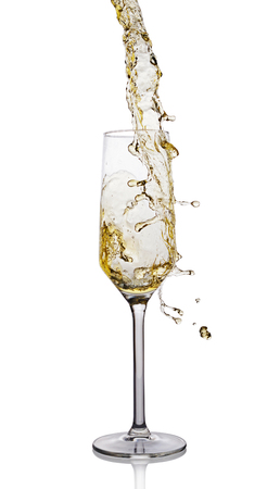 Splash of white wine in glass with reflection isolated on white background Stock Photo