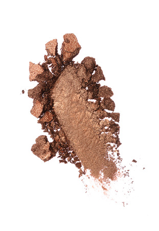 Smear of crushed shiny brown eyeshadow as sample of cosmetic product isolated on white background